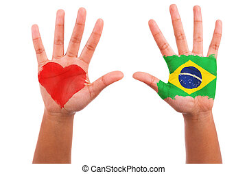 Brazilian hands with a painted heart and brazilian flag, i...