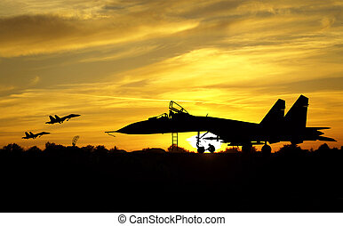 Airfield - Military aircrafts silhouettes on sunset...