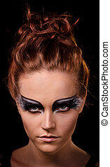 sharp look - portrait of a young woman with fantasy makeup