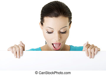 Shocked woman holding blank board, isolated on white