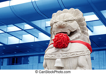 Traditional Chinese stone lions guard at the gate.