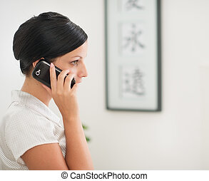 Young woman talking mobile phone