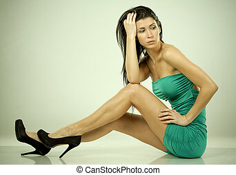 woman in green - pretty brunette wearing green dress on...