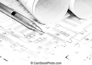 Rolled blueprint and pencil