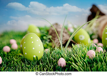 Colorful Easter eggs Holiday nature concept with easter hunt...