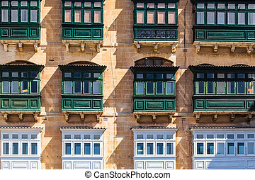 Valletta, Malta - Typical house facade with balconies in...