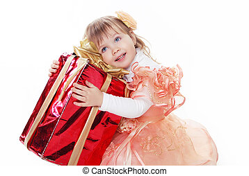 Little funny girl playing with gift box ribbon isolated on white background