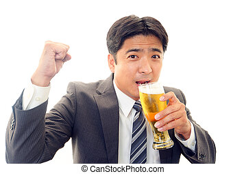 Man drinking beer - Happy Asian man drinking beer