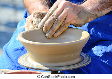 Potter's Hands - Hands Making Pottery On A Wheel