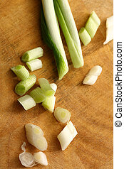 Chopped spring onions on preparation table