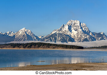 Tetons at Jackson Lake with snow - Jackson lake with the...