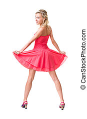 Full length of sensual woman in short dress dancing against...