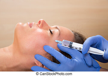 Anti aging facial mesotherapy syringe on woman face - Anti...