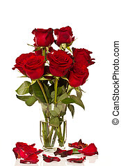 bouquet of roses in a glass vase on a white background