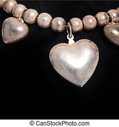 Necklace with a silver heart - Necklace of round silver...