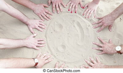 Hands draw a sun - The hands of five persons draw a sun....
