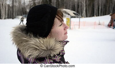 Young woman on ski resort
