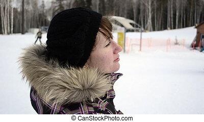 Young woman on ski resort