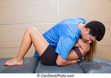 Osteopathy dorsal spine manipulation doctor to woman -...