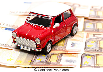 Car finance concept represented by a mini red car with a...