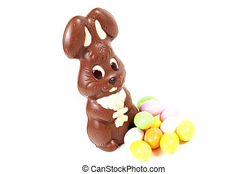 Easter bunny made of chocolate with easter egg isolated on a...