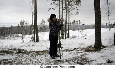 woman cleans snow skiing
