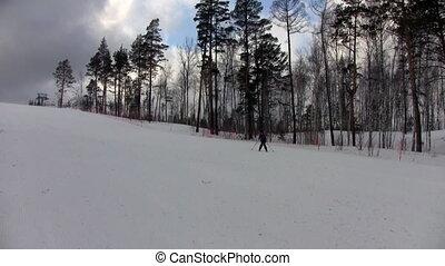Beginner skier roll downhill