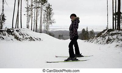 Woman jumps to ski on the mountain