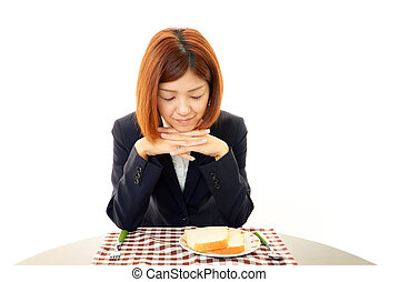 A woman with no appetite - Depressed Asian business woman.
