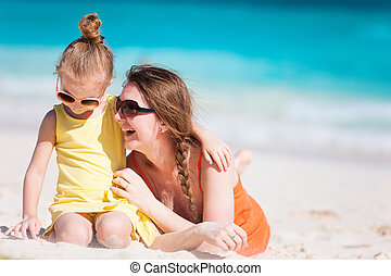 Mother and daughter at beach - Mother and daughter enjoying...