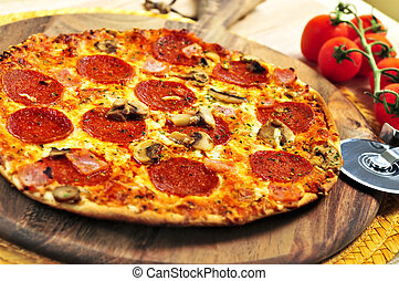 Pepperoni pizza - Freshly baked pepperoni pizza on wooden...