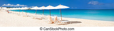 Panorama of a beautiful Caribbean beach - Chairs and...