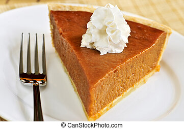 Pumpkin pie - Slice of pumpkin pie with fresh whipped cream