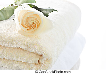 Stack of towels and rose - Stack of soft luxury towels with...