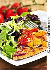 Vegetarian pizza with salad - Vegetarian meal of vegetable...