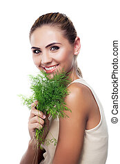 Close-up portrait of happy young woman with bundle herbs...