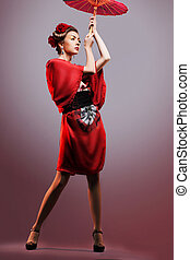 Fashion asian woman wearing traditional japanese red kimono...