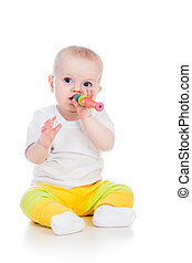 baby girl playing with musical toy isolated on white