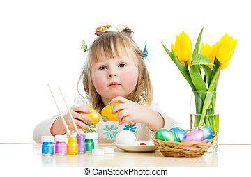 cute smiling baby girl painting Easter eggs isolated on white background