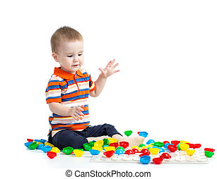 Cute child playing with  mosaic toy