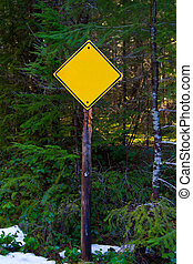 Blank Caution Sign - A yellow caution sign has no letters on...