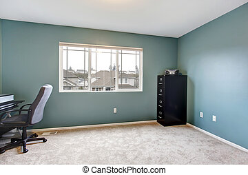 Simple home office room interior with blue walls.