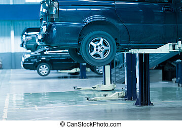 auto repair shop - Cars up on lifts in an auto repair shop