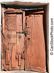 Old dilapidated wooden door. Rajasthan, India, Asia