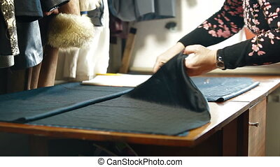 Custom Tailor Cutting a Sewing Pattern