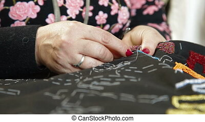 Beadwork - Woman doing beadwork