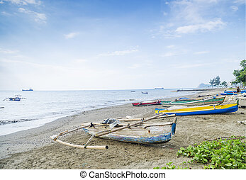 fishing boats on dili beach east timor - fishing boats on...