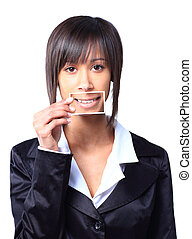 Girl holding a card with photo her smile in front of her mouth