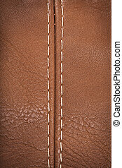 Seam on a leather - Closeup view of leather material jointed...