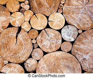 Stacked logs, wooden background